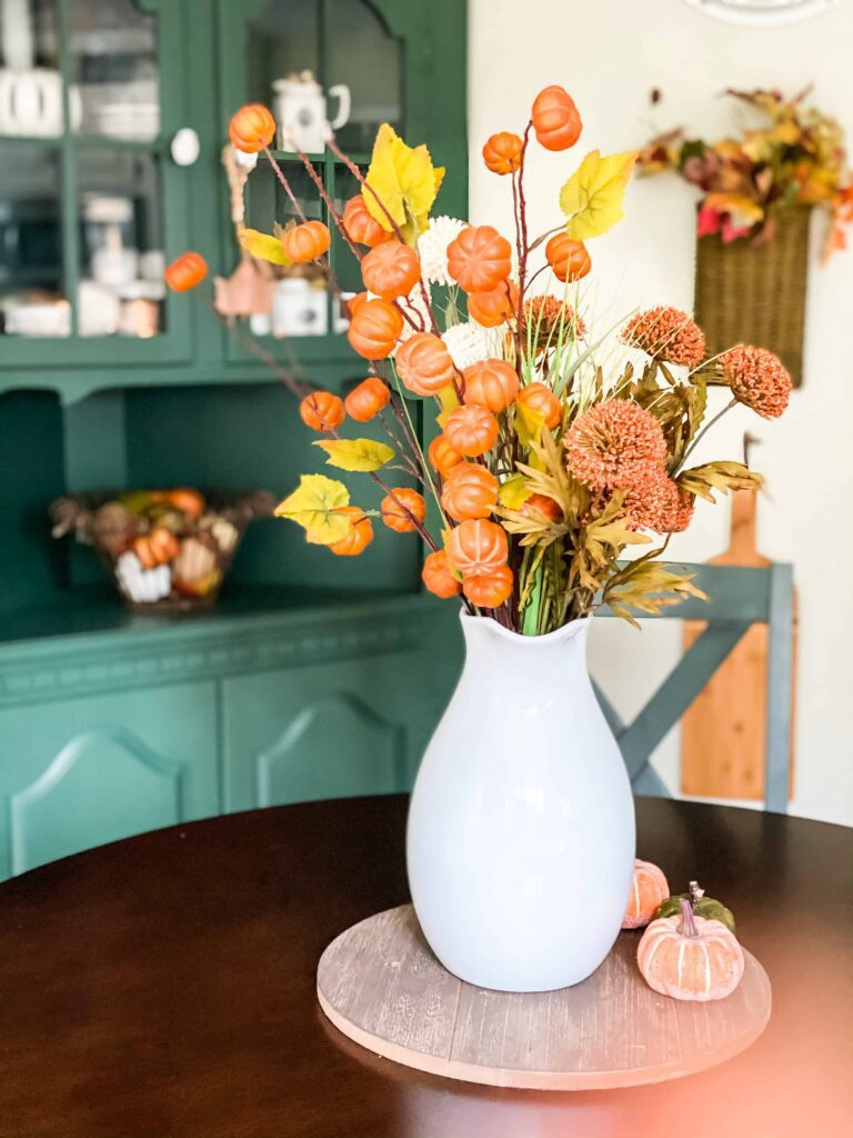 fall flowers in white pitcher