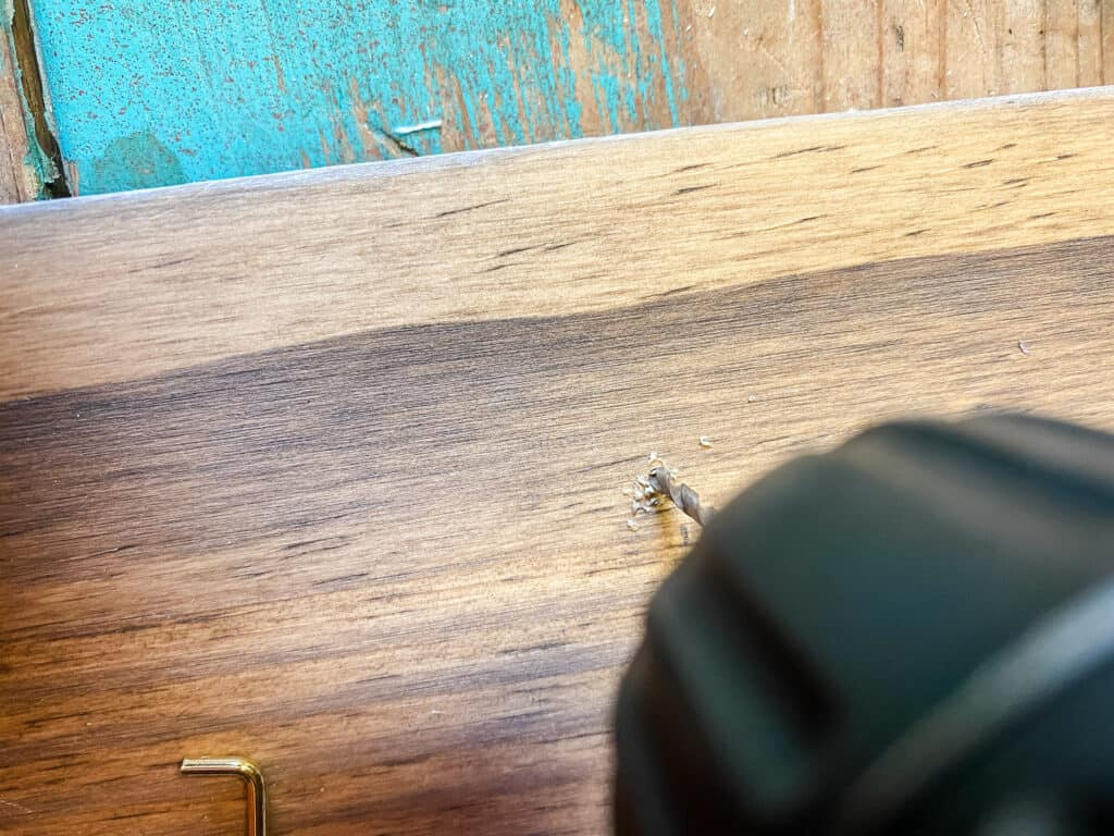 drilling pilot holes into the board