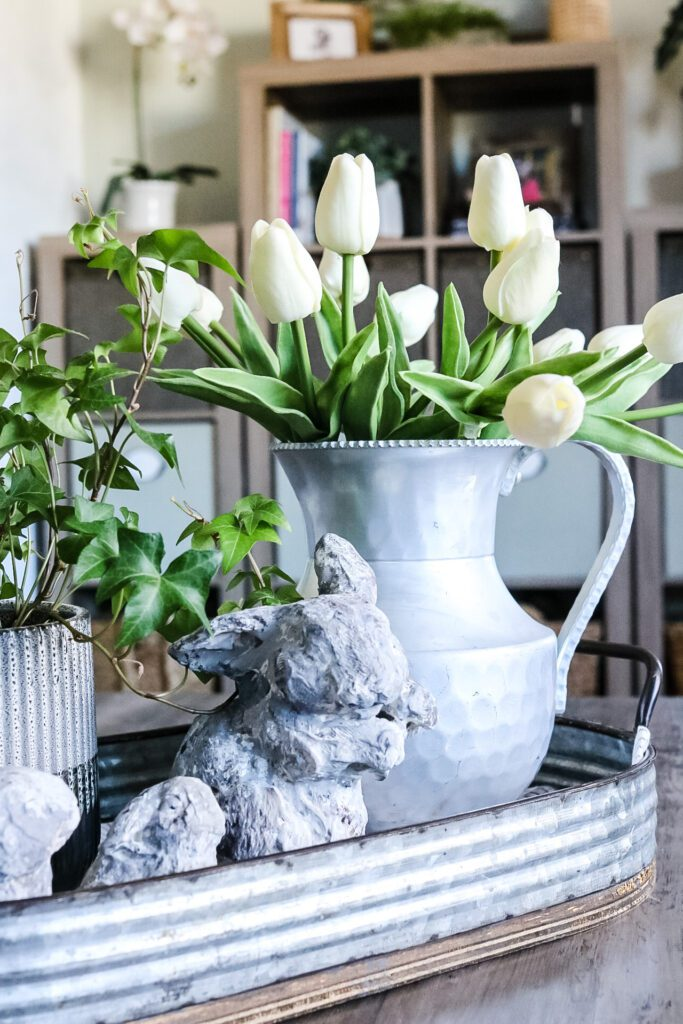 white tulips in a pewter vase