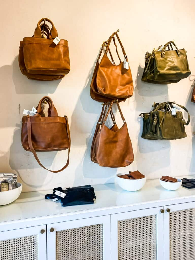 wall of leather bags at Magnolia Market