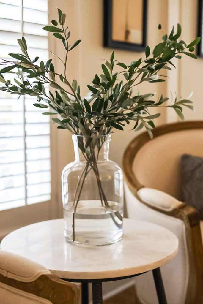 vase of greenery on table