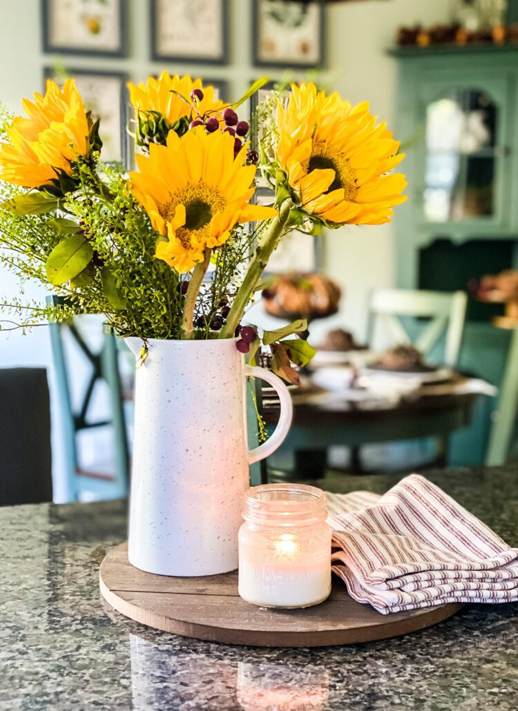 sunflowers in white pitcher